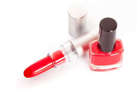 Red lipstick and nail polish on a white background Stock Photo