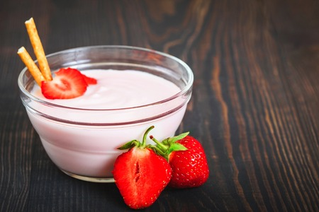 Healthy and tasty dessert of strawberries with yogurt for breakfast. Delicious and flavorful berry dessert.