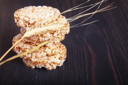 caloric: Dietary a low caloric grain crackers on a dark wooden background
