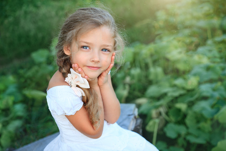 glades: Cute little girl on nature in bright summer day