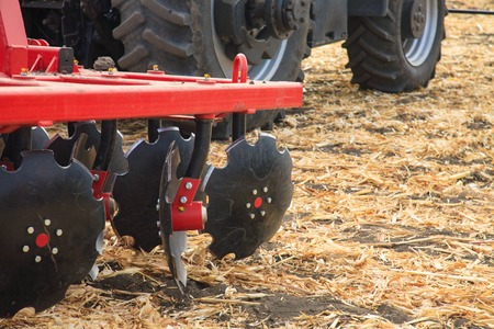 Agricultural disc harrow, close-up on the ground, farm equipment Stock Photo