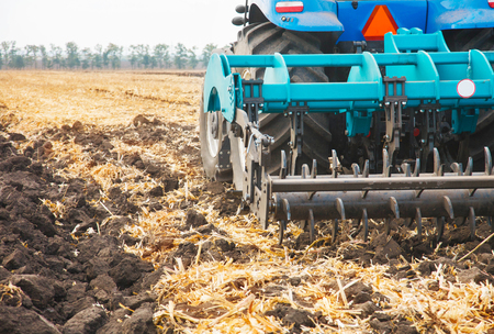 Agricultural machinery in the field. Cultivator close-up. Stock Photo