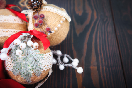 Christmas decoration. New Years decor. Copy space. Christmas tree toys on a wooden background.