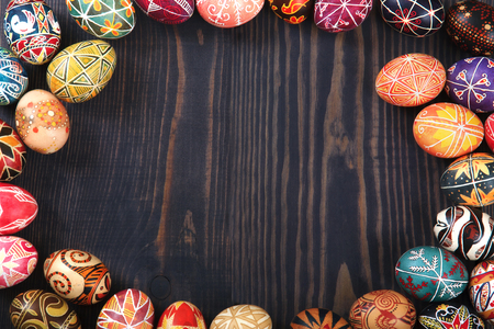 Easter decorated eggs on a wooden background. Copy space, easter background. Stock Photo