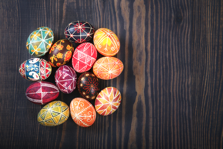 Easter decorated eggs on a wooden background. Copy space, easter background. Stock Photo - 117584674