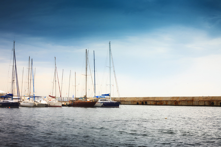 Yachts at the berth in the port. Landscape with boats. Morning at sea. Stock Photo