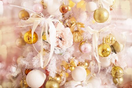 Decorated Christmas tree close-up, Christmas balls and garlands. Winter holidays.