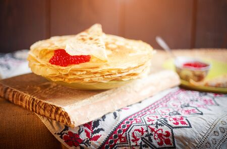 Homemade hot pancakes with caviar. Rustic style, crepes close-up.