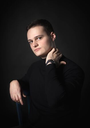 Portrait of an attractive man in the studio on a black background.
