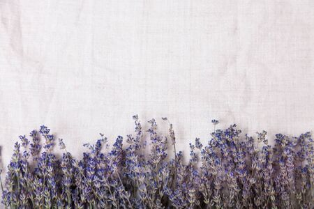 Beautiful floral background with lavender on a fabric background, top view. Rustic or vintage background. Hight quality photo