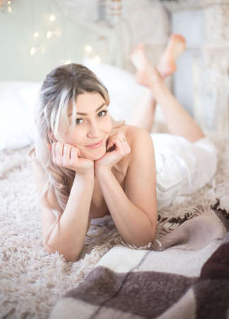 Cute beautiful woman in the morning in bed, vintage style. High quality photo Banco de Imagens