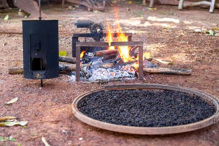 roasting coffee the old farm way, manual roaster, wood fire.