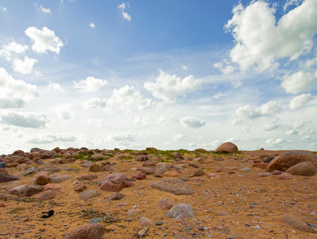 uninhabited: Uninhabited landscape with rocks against the background of a cloudy sky. Stock Photo