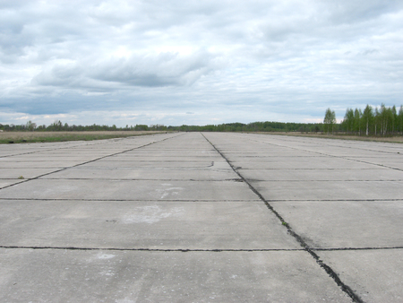 Runway for military planes in field airfield. Фото со стока