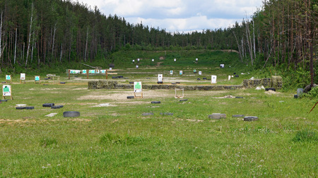 Shooting range with targets in the clearing