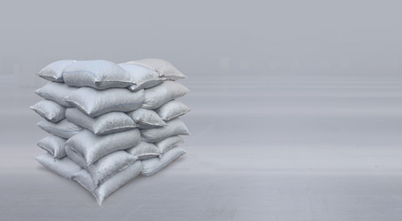 Filled large bags with content stacked together. Stock Photo