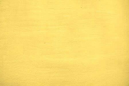 The texture is plastered and painted in a yellow wall.