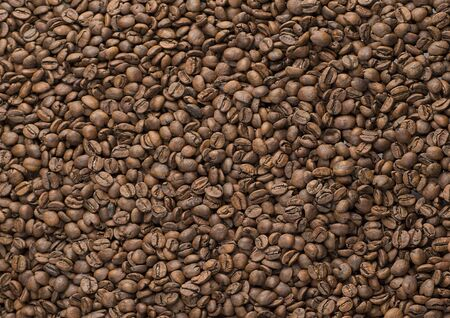 Texture of roasted coffee beans. Coffee grains background.