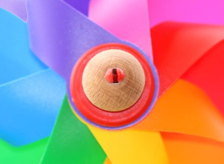 Colored plastic and wood wind toy photo