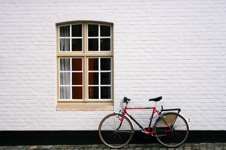 streetlamp: Window and Bicycle on a white bricks wall Stock Photo