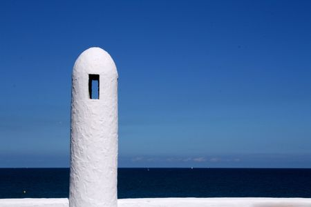 White handrail of a Mediterranean beach photo
