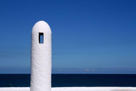 handrail: White handrail of a Mediterranean beach
