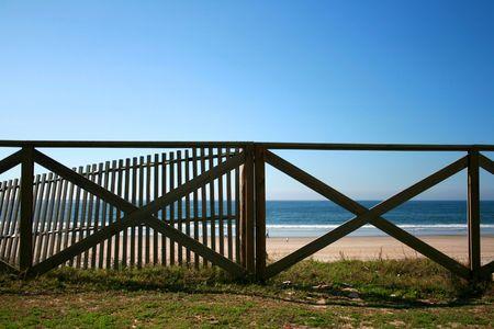 Wood handrail of a Mediterranean beach Stock Photo - 3828621