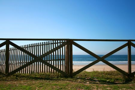 Wood handrail of a Mediterranean beach Stock Photo - 3828621