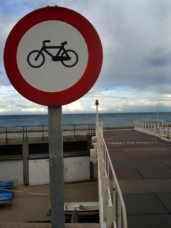 Cycling forbiden traffic signal on a harbour                              Stock Photo