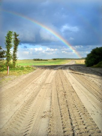 Rainbow ona sand and grass flat field. Stock Photo - 3828630