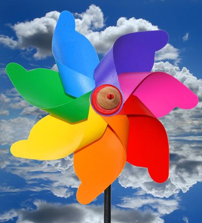 Colored plastic and wood wind toy