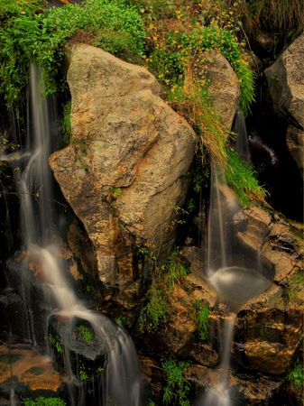 Movement between the roks of a river waterfall Stock Photo - 3877711
