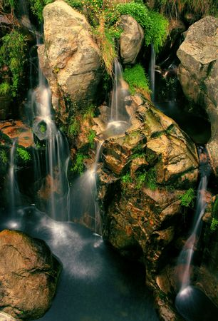 Movement between the roks of a river and waterfall photo