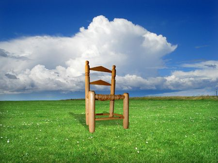 Wood chair on a grass field photo