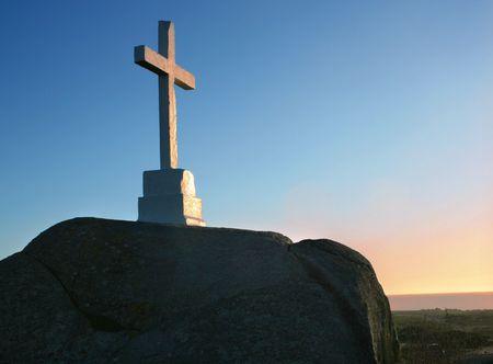 White cross on a rock photo