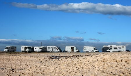 Automobile homes on a beach