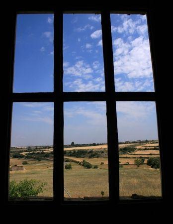 meadow through a old broken window photo