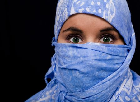 Beautiful young woman coated by scarf photo