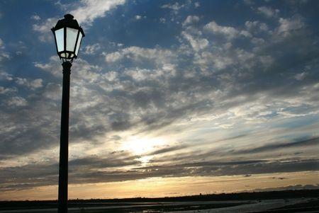 Street ligth on a beach sunset