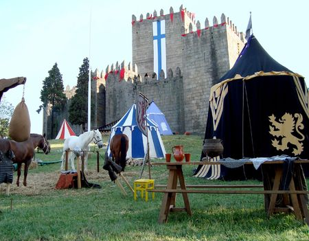 medieval castle and tents on a horse tournament