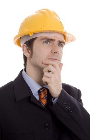 trabajo: man thinking with yellow helmet white isoalte