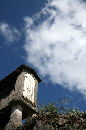small constructuin typical from nord of portugal on a blue sky photo