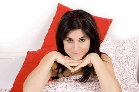 Young beautiful woman on a bed wearing a black pyjama