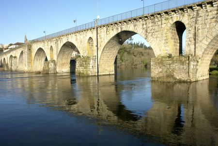 Reflection of a bridge on a river in Portugal