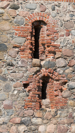 loopholes: Stone wall of an old castle with loopholes Stock Photo