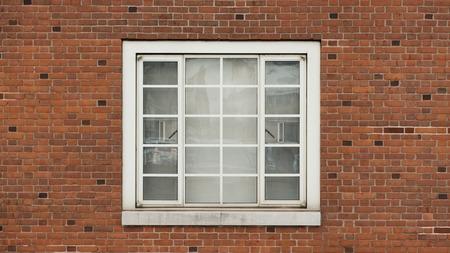 Window on brick red wall