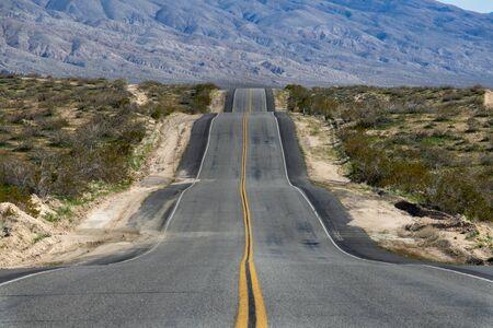 Uneven highway in desert Stock Photo