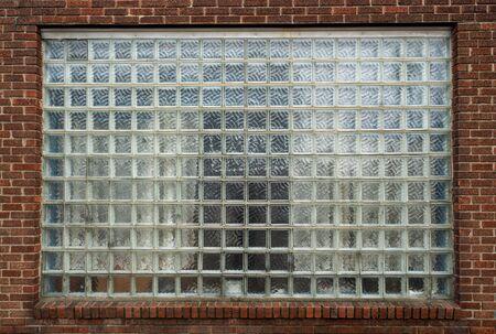 Square glass window in brick wall