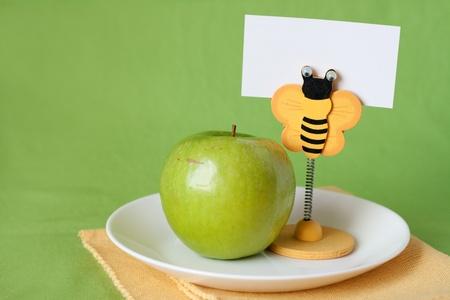 Green apple for breakfast clothespin with card for text photo