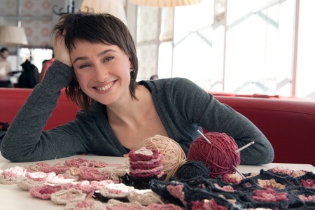 Portrait of a young beautiful girl with knitting